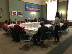Dr. Jennifer Jones explains the Cancer Rehabilitation and Survivorship Program to caucus attendees.